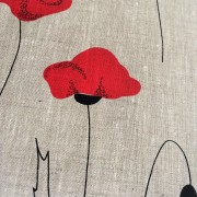 Linen tea towel in Poppy pattern on grey