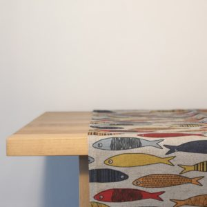 Pure 100% linen table runner. Handmade table linen. Colorful fishes pattern on grey.
