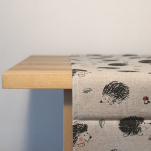 Pure 100% linen table runner. Handmade table linen. Hedgehog pattern on grey.