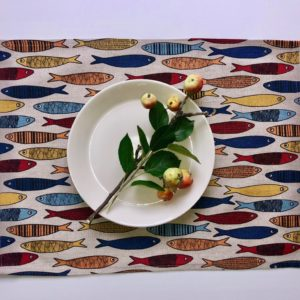 Pure 100% linen table placemats. Handmade table linen. Colorful fishes pattern on grey.