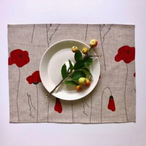 Pure 100% linen table placemats. Handmade table linen. Poppy flower pattern on grey.