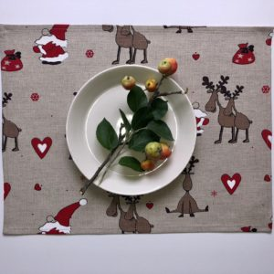 Pure 100% linen table placemats. Handmade table linen. Christmas reindeers pattern on grey.