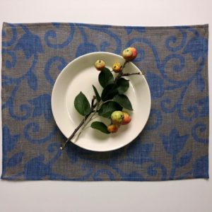 Pure 100% linen table placemats. Handmade table linen. Floral ornament pattern on grey.