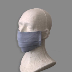 Baby blue linen reusable washable mask with straps.