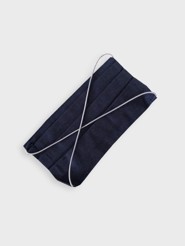 Navy blue linen reusable washable mask with straps.